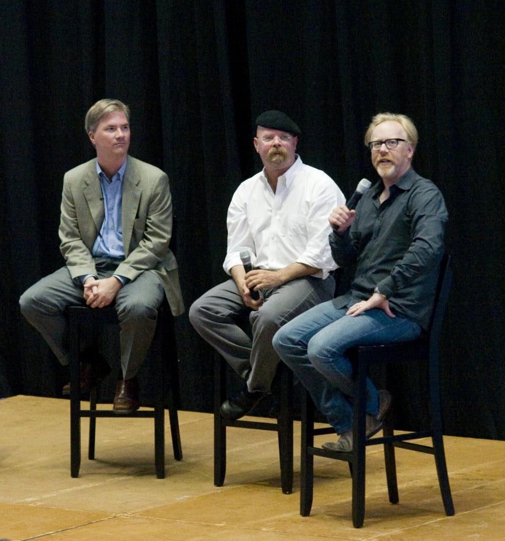 Chancellor Holden Thorp talks with Jamie Hyneman and Adam Savage from Discovery Channel's MythBusters in the Dean Dome.
