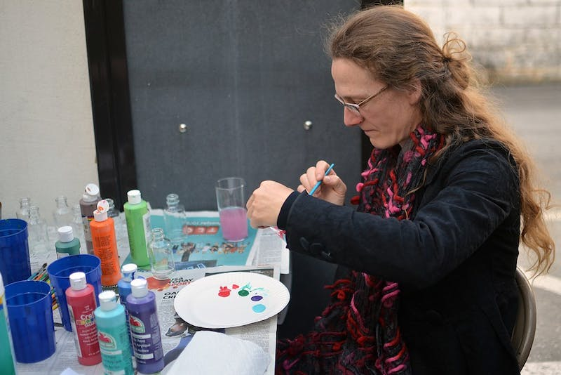 Sarah Wolfe, a resident of Durham, enjoys painting a glass bottle at Lantern Restaurant. She is a curator for Windows in the Chapel Hill area.