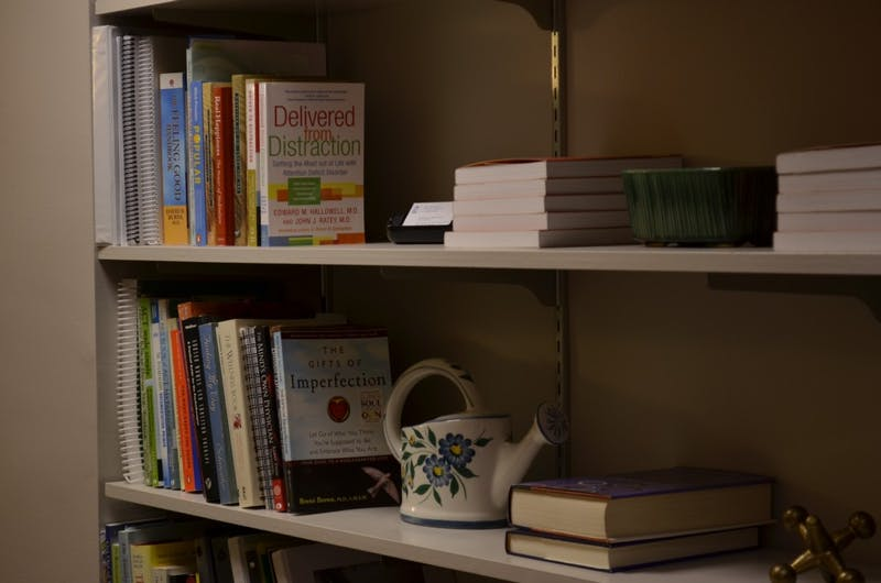 The bookcase inside the office of Dr. Witt, a CAPS counselor. The Clinical and Psychological Services (CAPS) held an event for students to talk about their mental health experiences on Monday, Nov 12, 2018.