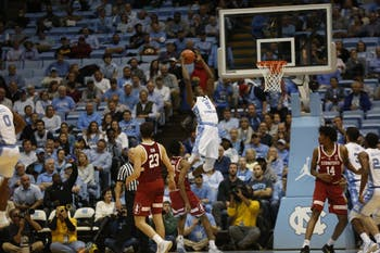 Nassir Little (5) dunks in Monday's 90-72 win over Stanford.