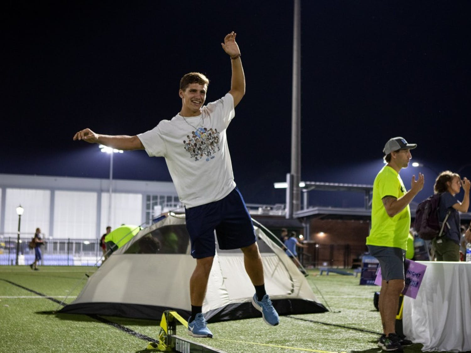 Luke Eggleston, a junior economics major, balances on the slack line during Fallfest on Hooker Fields on the evening of Sunday, August 18 2019.