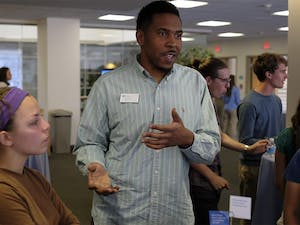 UNC student Keelon Dixon discusses social media anonymity with other  students at the Carolina Conversations panel on Tuesday evening.