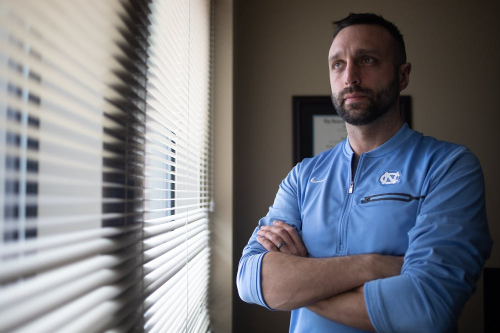 <p>Matt Jednak, UNC's head fencing coach, poses for a portrait in his office on Friday, Jan. 24, 2020.</p>
