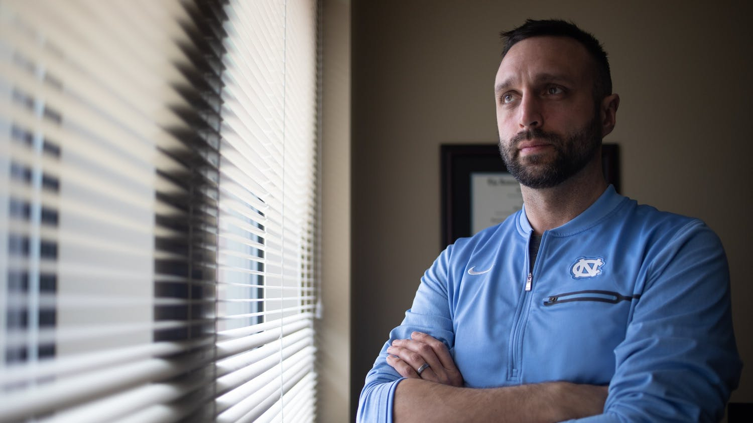 Matt Jednak, UNC's head fencing coach, poses for a portrait in his office on Friday, Jan. 24, 2020.