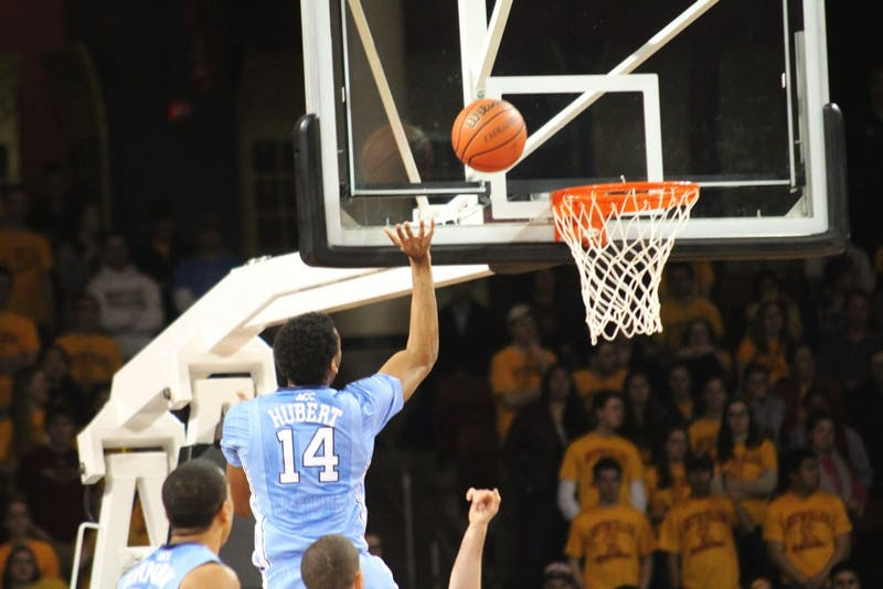 Desmond Hubert goes for an offensive rebound after a missed shot in the first half.