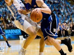 """Tyler Hansbrough has helped lead the Tar Heels on defense with his knack for drawing charges"""" seen here against Duke?s Kyle Singler on March 8."""
