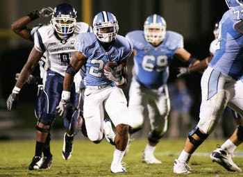 "Shaun Draughn scored UNC?s third touchdown of the night on this 39-yard run in the third quarter. The sophomore"" who played safety last year had 109 yards on 19 carries and never lostyards against the Huskies. ?Ever since I moved to running back I?ve been having fun? Draughn said."