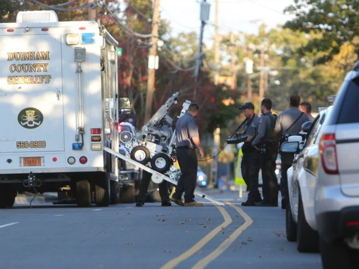 Durham County Bomb Squad deploys a bomb robot on Weaver St. in Carrboro in connection to the explosion at McCorkle Place on Thursday afternoon.