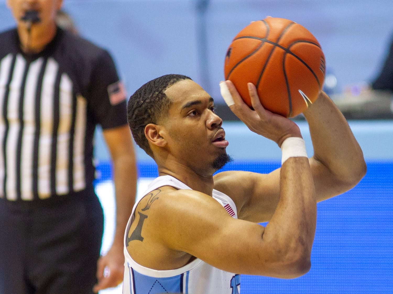 UNC senior forward Garrison Brooks shoots a free throw  at the game against Louisville on Saturday, Feb. 20 2021 at the Smith Center in Chapel Hill. UNC won 99-54.