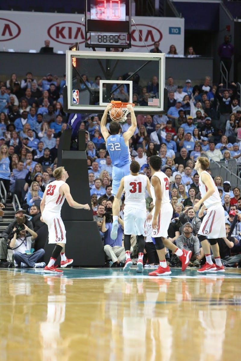 Forward Luke Maye (32) dunks against Davidson on Friday in the Spectrum Center in Charlotte.