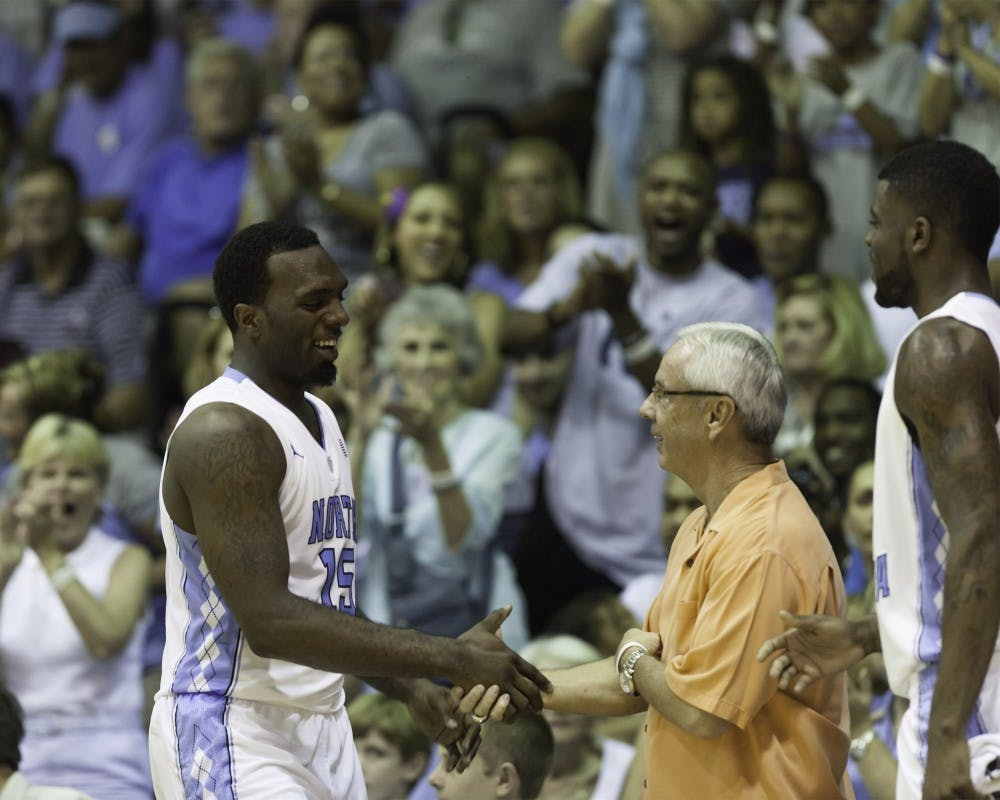 "<p><span class=""caps"">UNC</span> coach Roy Williams shakes P.J. Hairston&#8217;s hand on the sideline. Hairston had 18 points in the first-round Maui Invitational victory.</p>"