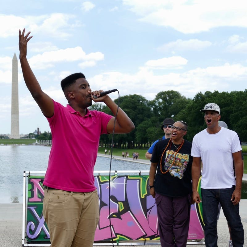 Rapper Joshua Rowsey, also known as (J) Rowdy, performing outside the Washington monument. Photo courtesy of Mark Katz.