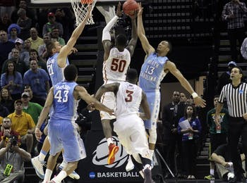 Iowa State's DeAndre Kane hit the game winning shot over Jackson Simmons and JP Tokoto. The UNC men's basketball team lost to Iowa State 85-83 in the third round of the NCAA tournament.