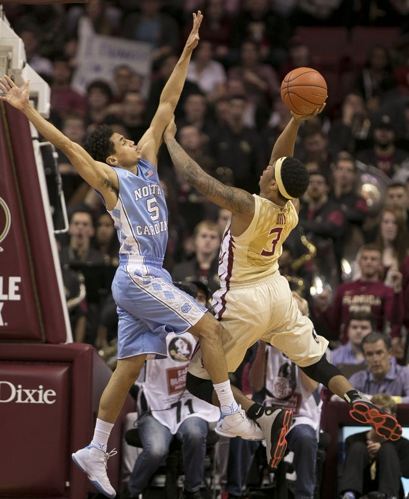 Florida State's Benji Bell (3) puts up a shot against North Carolina's Marcus Paige (5) during the first half on Monday, Jan. 4, 2016, at the Tucker Center in Tallahassee, Fla. (Robert Willett/Raleigh News & Observer/TNS)