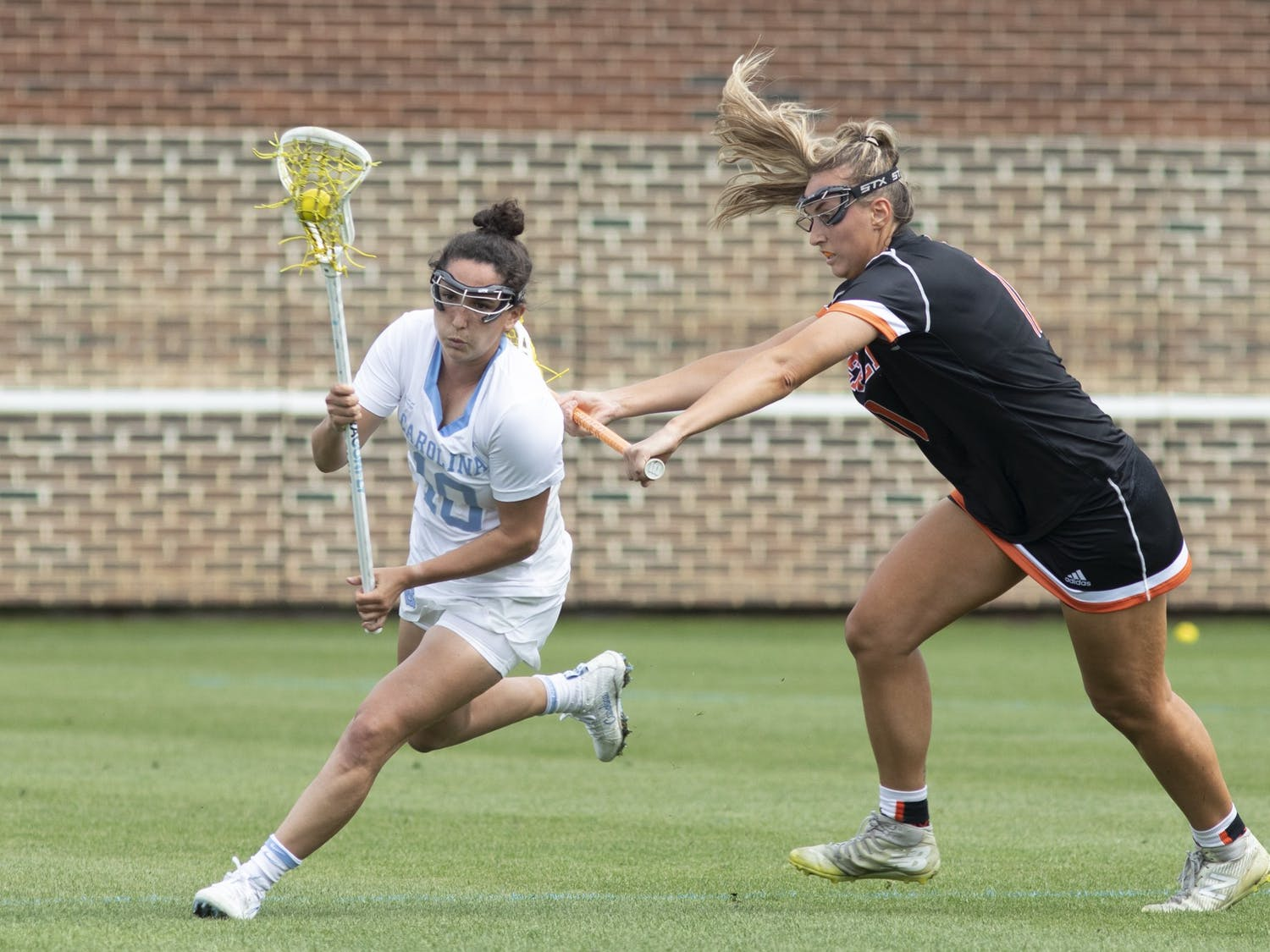 First-year midfielder Alyssa Long (10) runs up the field against Mercer at Dorrance Field on March 27, 2021. UNC beat Mercer 18-5.