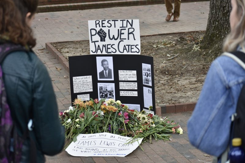 People rallied in the Pit in support of Maya Little before placing flowers  at the site where James Cates was killed in 1970.