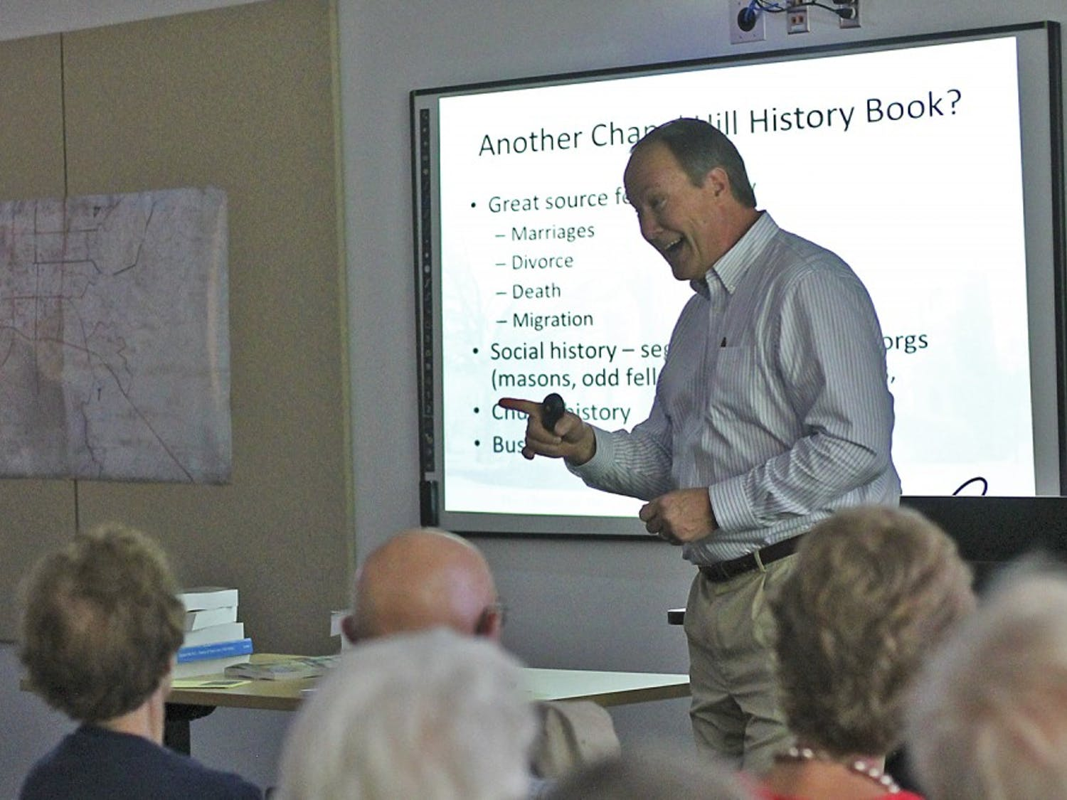 "Author Stuart Dunaway presents ""A Historical Overview of the Village of Chapel Hill"" to a packed room in the Chapel Hill Public Library on Sunday afternoon."