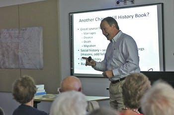 """Author Stuart Dunaway presents """"A Historical Overview of the Village of Chapel Hill"""" to a packed room in the Chapel Hill Public Library on Sunday afternoon."""
