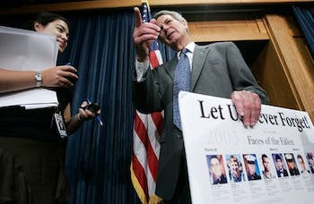 U.S. Rep. Walter Jones (R-NC) (R) talks to a reporter after a news conference on Capitol Hill in 2005. the ailing congressman will be sworn in, in a private ceremony. (Alex Wong/Getty Images)