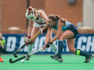 UNC Senior forward Marissa Creatore (33) steals the ball from Boston College player in the NCAA Final Four game against BC at Kentner Stadium on Friday, Nov. 22, 2019. UNC won 6-3, advancing the team to the final round of the NCAA Championships.