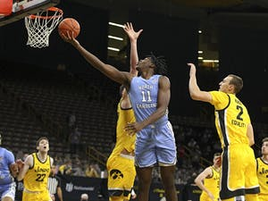 North Carolina Tar Heels forward Day'Ron Sharpe (11) makes a basket during the second half of their B1G/ACC Challenge  game at Carver-Hawkeye Arena in Iowa City, Iowa on Tuesday, December 8, 2020. Photo courtesy of Stephen Mally/hawkeyesports.com
