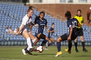 UNC first year midfielder Sam Meza (1) and junior midfielder Rachel Jones (10) fight for the ball with Clemson sophomore midfielder Hal Hershfelt (15) during a game at Dorrance Field on Thursday, Oct. 1, 2020. UNC beat Clemson 2-0.