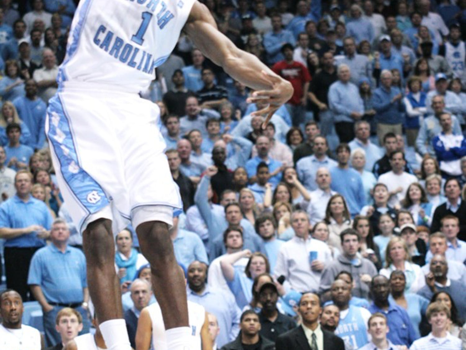 Sophomore Dexter Strickland dunks to earn two of his nine points to cap a late UNC drive that sealed a win against College of Charleston.