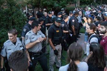 Police formed a barricade to hold off protestors around Hyde Hall after detaining a man during a protest in August.