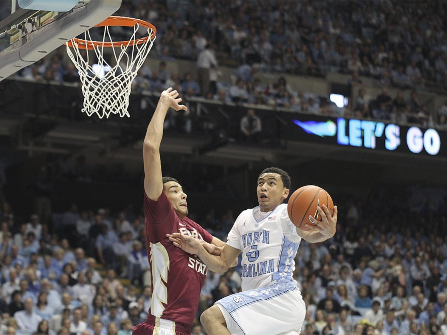 Junior point guard Marcus Paige goes up for a layup against a Florida State defender in a game on Feb. 17, 2014.