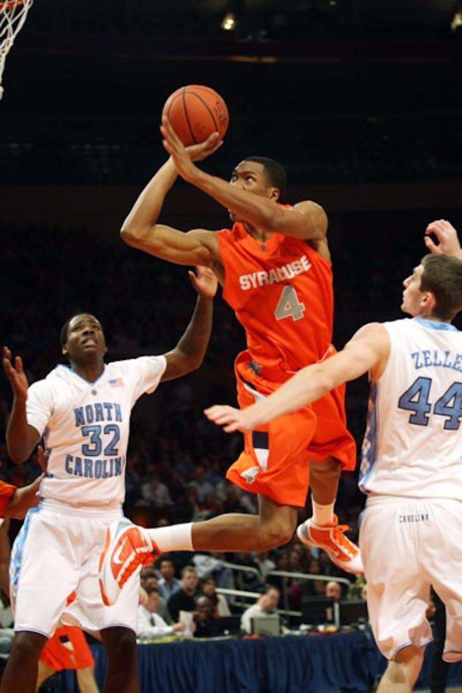 Syracuse forward Wesley Johnson shoots against UNC's Ed Davis and Tyler Zeller.