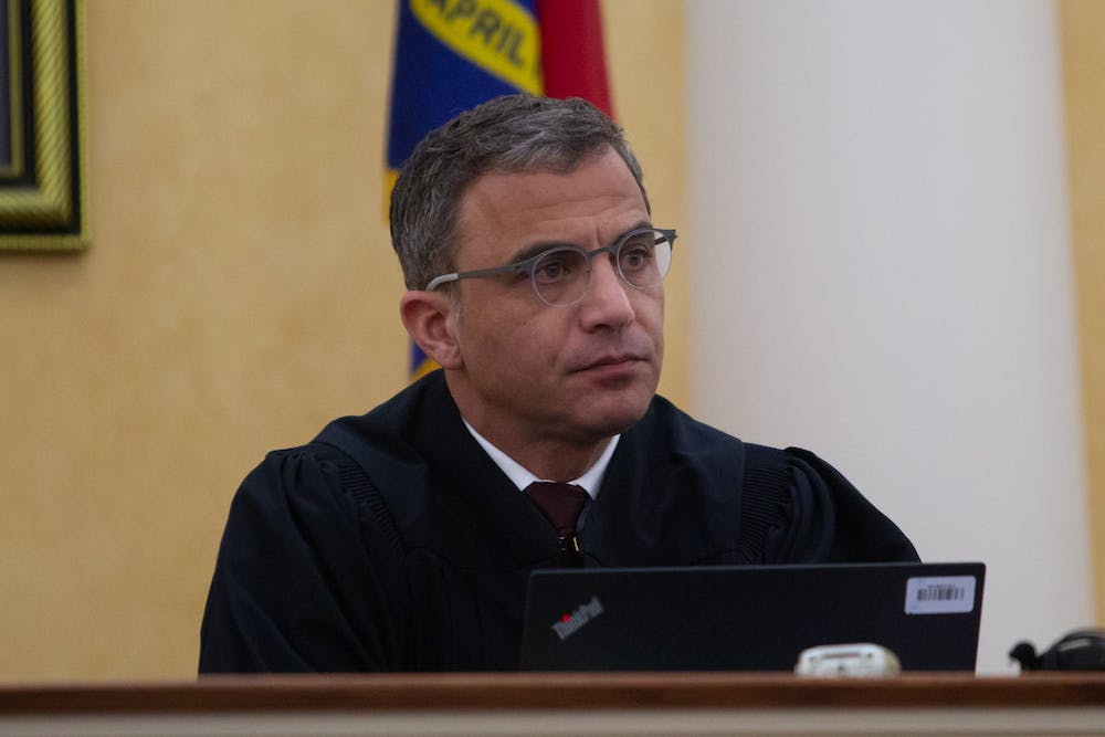 <p>Judge Allen Baddour looks on as SCV lawyer Boyd Stourges speaks during the hearing on Wednesday, Feb. 12, 2020. Judge Baddour ruled to vacate the consent order an dismiss the lawsuit regarding Silent Sam.</p>