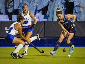 UNC senior forward Erin Matson (1) maintains possession as she drives into the goal during the Tar Heels' home game on Oct. 8 against the Duke Blue Devils. UNC won 4-1, and Matson scored her 100th career goal as a Tar Heel.