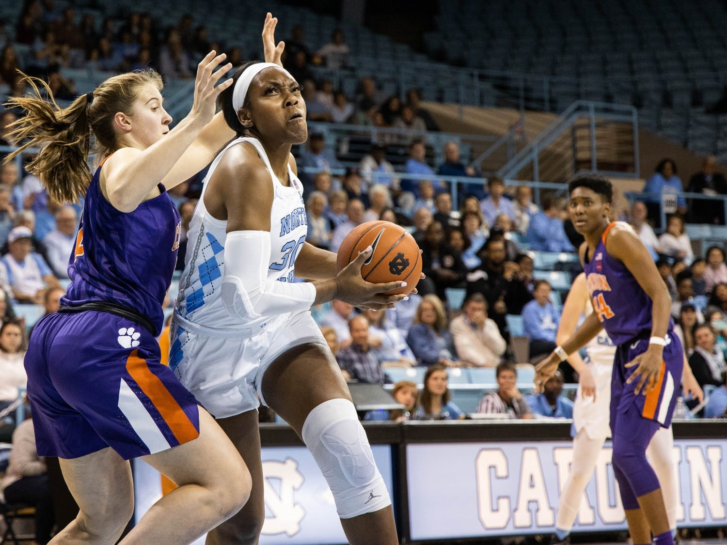 UNC junior center Janelle Bailey (30) pushes past Clemson University freshman center Hannah Hank (12). The Tar Heels beat the Tigers 86-72 on Sunday, Feb. 2, 2020 in Carmichael Arena.