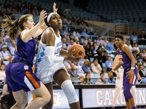 UNC junior center Janelle Bailey (30) pushes past Clemson University freshman center Hannah Hank (12). The Tar Heels beat the Tigers 86-72 on Sunday, Feb. 2, 2020 in Carmichael Arena.