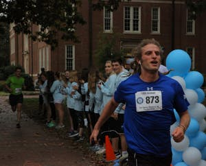 Masters student Gabe Zieff powers through the finish line at the Eve Carson 5k on Saturday.