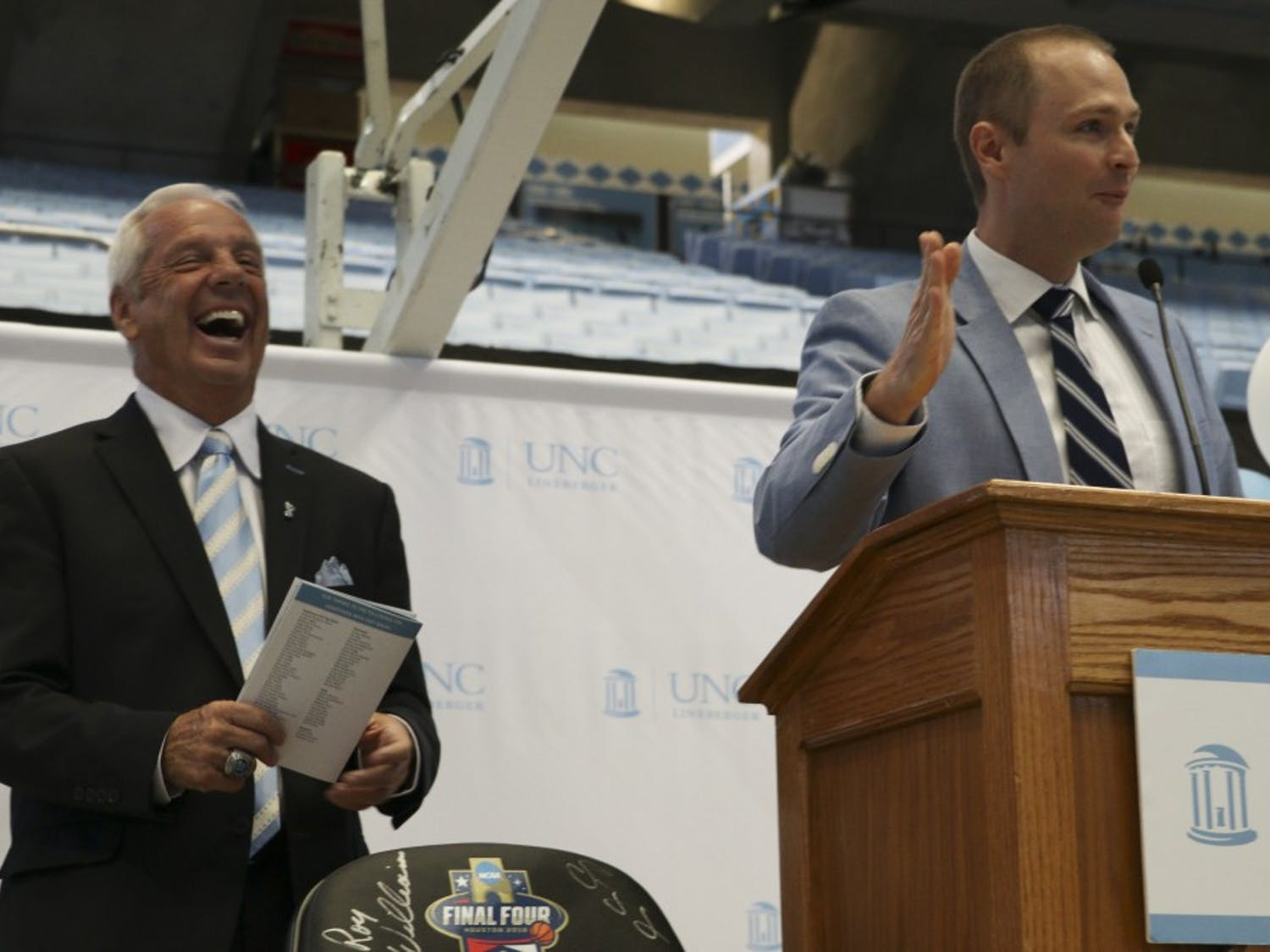 UNC play-by-play announcer Jones Angell and men's basketball head coach Roy Williams address the crowd at Williams' Fast Break Against Cancer event in the Smith Center on Monday, Oct. 2, 2017.