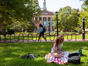 A student studies on the quad near Carroll Hall while adhering to social distancing guidelines on Tuesday, Sept. 15, 2020.