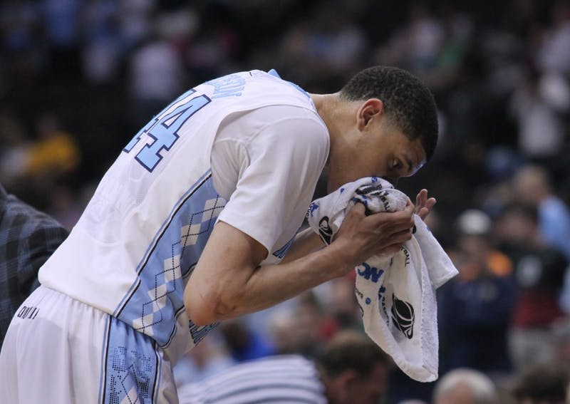 UNC freshman Justin Jackson (44) gets a bloody nose during Saturday's game.The Tar Heels defeated the Arkansas Razorbacks, 87-78, on Saturday in Jacksonville, Fla.