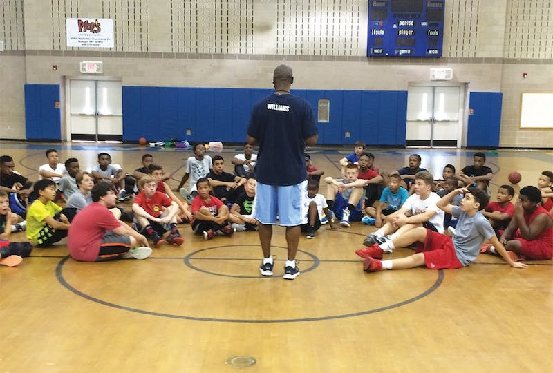 Donald Williams, a former NCAA National Championship winner, hosts a summer basketball camp for children in the community.