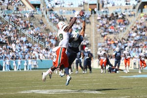 Wide receiver Beau Corrales (88) extends for a 26-yard catch against Miami on Saturday in Kenan Stadium.