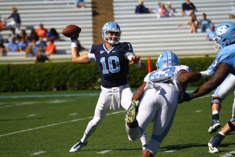 Quarterback Mitch Trubisky (10) prepares to throw a pass downfield.