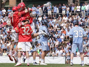 Maryland lacrosse players celebrate a goal during the first half of their 15-7defeat ofUNC. North Carolina claimed the NCAA title the last time the two teams played each other in May.
