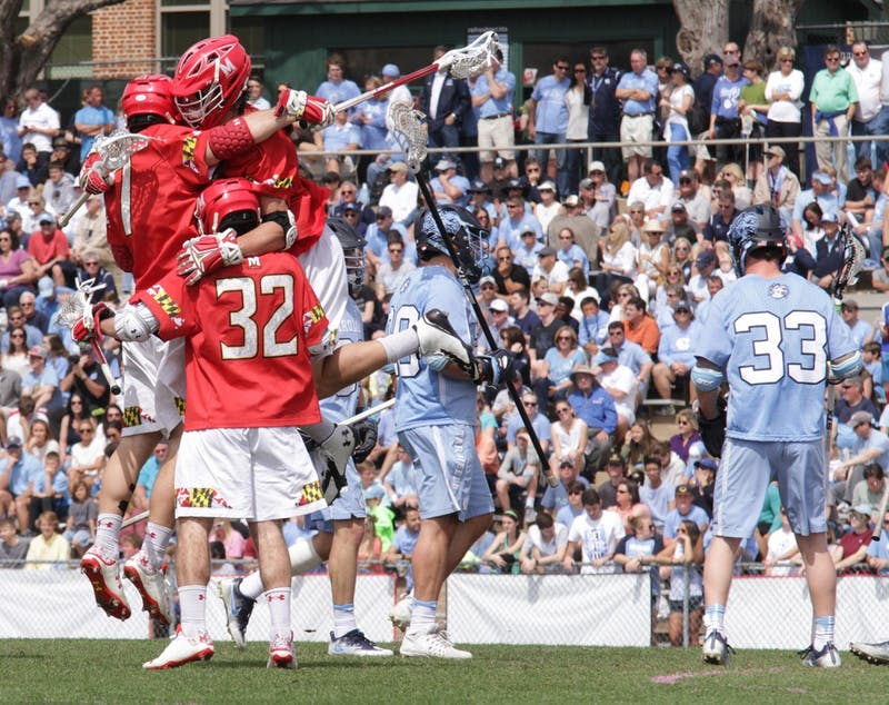 Maryland lacrosse players celebrate a goal during the first half of their 15-7 defeat of UNC. North Carolina claimed the NCAA title the last time the two teams played each other in May.