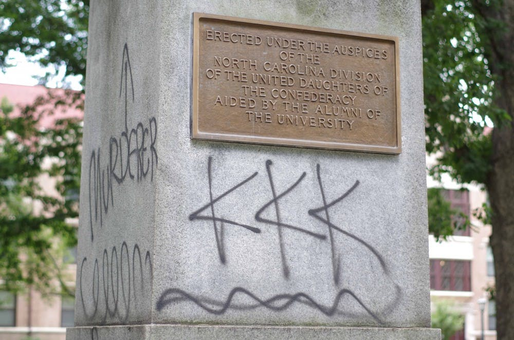 "<p>The Silent Sam monument, which is dedicated to students who died serving in the Confederate Army, was spray painted with ""black lives matter,"" ""KKK"" and ""murderer.""</p>"