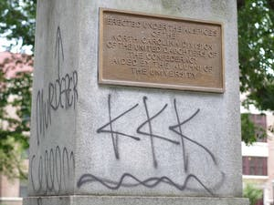 """TheSilent Sam monument, which is dedicated to students who died serving in the Confederate Army, was spray painted with """"black lives matter,"""" """"KKK"""" and """"murderer."""""""