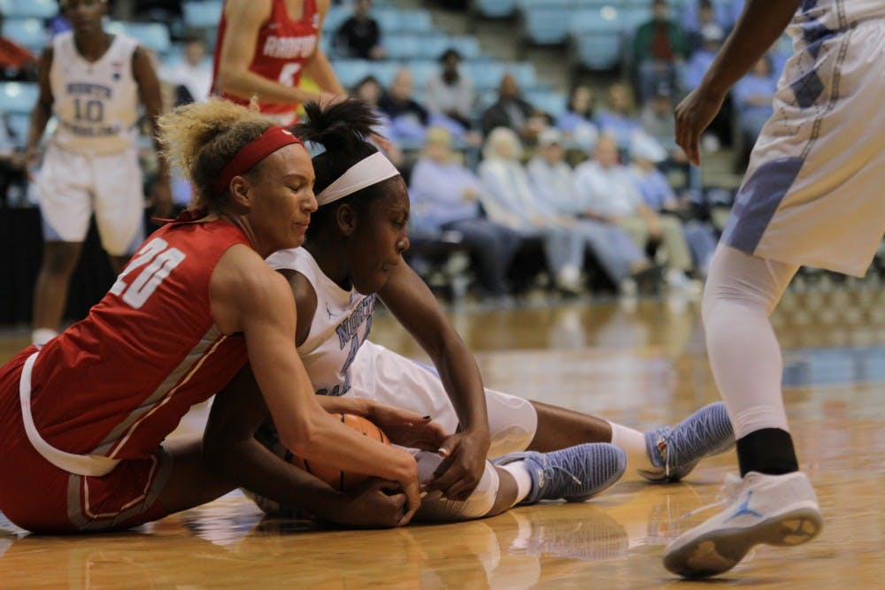 <p>Forward Janelle Bailey (44) fights for a ball against Radford on Thursday night in Carmichael Arena.</p>