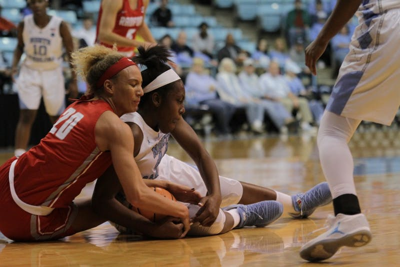 Forward Janelle Bailey (44) fights for a ball against Radford on Thursday night in Carmichael Arena.