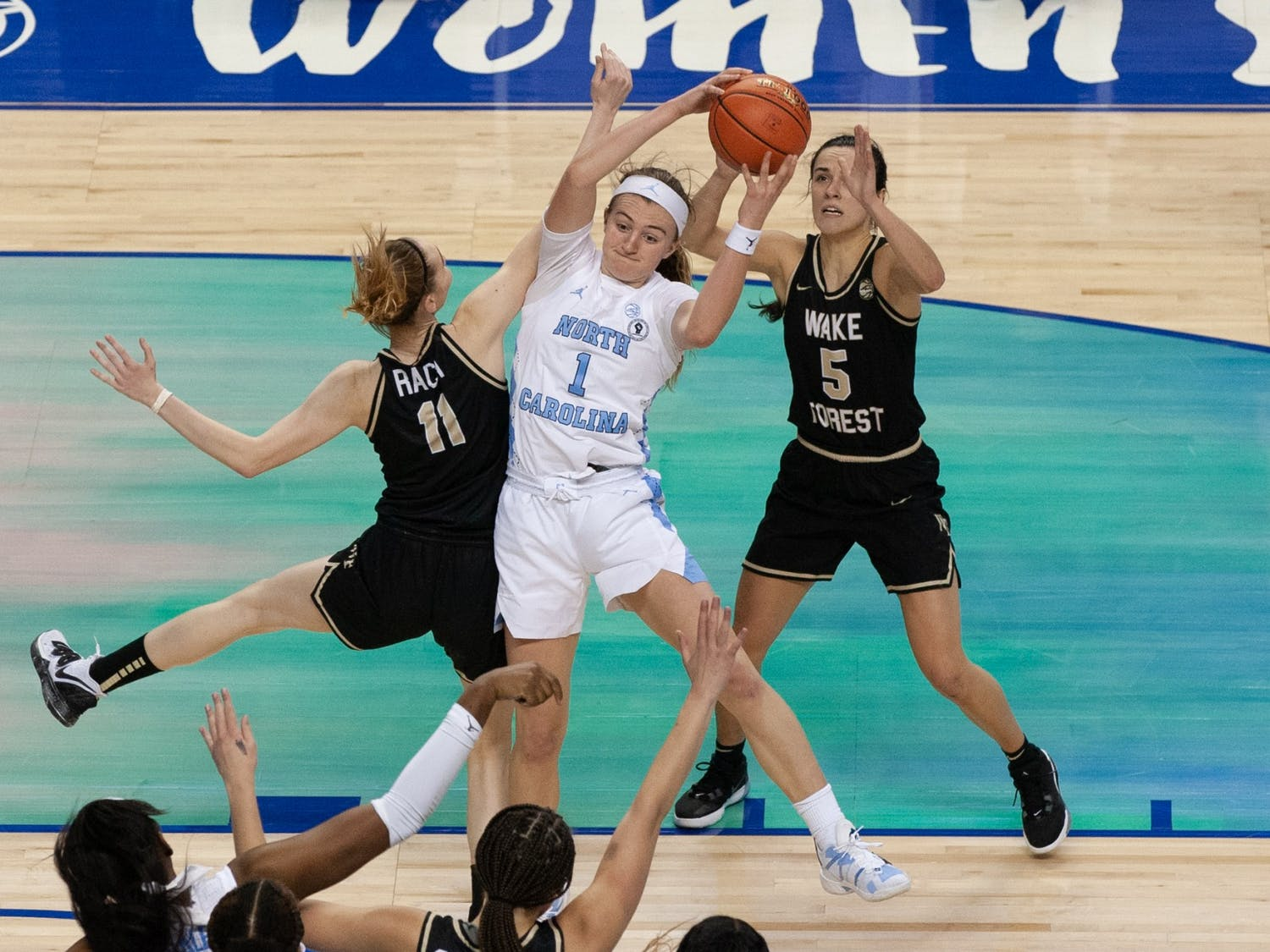 UNC first year forward Alyssa Utsby pulls down a rebound in Carolina's second-round game against Wake Forest University at Greensboro Coliseum on Mar. 4, 2021.