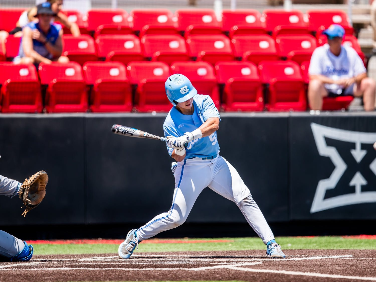 UNC first-year catcher Tomas Frick (52) hits the ball at the NCAA tournament game against UCLA on Sunday June 6, 2021 in Lubbock, TX. The Tar Heels lost 2-12. Photo courtesy of Elise Bressler.