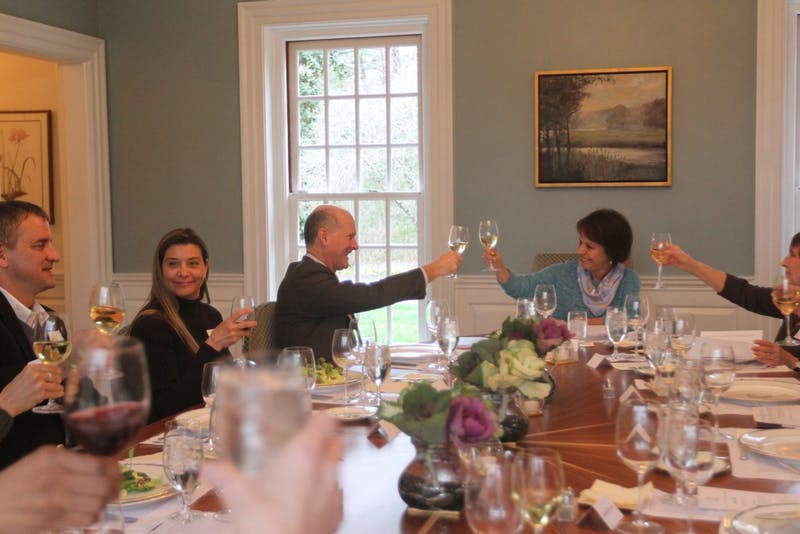 The Faculty Athletics Committee toasts before a meeting at Chancellor Folt's house on Wednesday night.